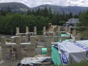 Outside roof pillars finished. Inner pillars will be poured after beams are lowered onto roof.