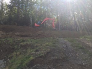 Digging up on the hill. Making it smooth.