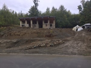 A mud pit after excavating for electrical, water, and sewage. More gravel needed.