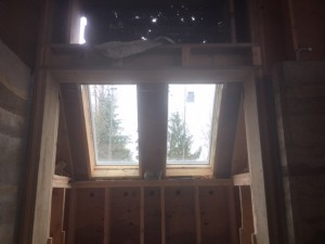 Skylight framing done. But far from waterproof. Have to keep them covered in plastic till I have time to do the flashing and siding.