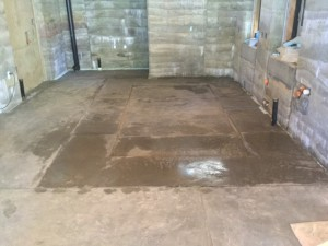 Concrete floor in kitchen with lower level for future electric floor heat.