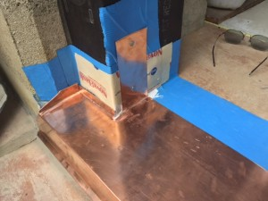 Copper Door flashing for looks and protection.
